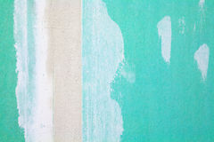Gypsum plasterboard. Close up of a green gypsum plasterboard wall as architecture background Stock Image