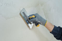 Gypsum puttying manually. Stock Photo