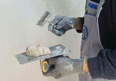 Gypsum puttying manually. Stock Photography