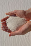 Gypsum sand in hands Stock Images