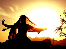 Gypsy dancer against sun Royalty Free Stock Image
