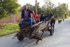 Gypsy family. Traditional horses and cart on the street in a village with a gypsy family Stock Image