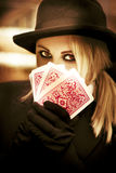 Gypsy Fortune Teller. Mysterious Woman Gypsy Fortune Teller Holds Tarot Cards In A Psychic Reading Revealing Future Fortunes Royalty Free Stock Photos