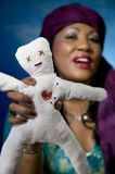 Gypsy Fortune Teller. With an unfortunate voodoo doll Stock Image