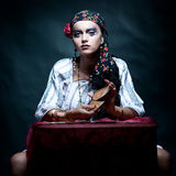 Gypsy Fortune Teller Mixing The Tarot Cards. Stock Images
