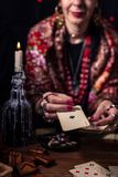 Gypsy fortune teller predicts the future. With cards royalty free stock photos
