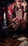 Gypsy fortune teller predicts the future. With cards royalty free stock photography