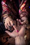 Gypsy fortune teller predicts the future. By chiromancy stock images