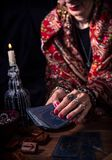 Gypsy fortune teller predicts the future. With cards royalty free stock images