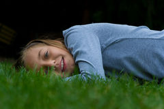Gypsy girl in autumn grass smiling stock photo