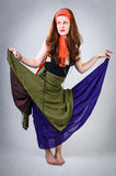 Gypsy girl shows long skirt Royalty Free Stock Images