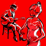 Gypsy guitar jazz player and woman dancing Royalty Free Stock Photos