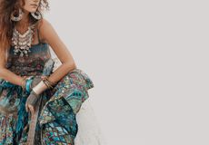 Gypsy hippie styled young woman with guitar. Gypsy hippie styled fashion model with lot of accessories stock photography