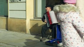 OLOMOUC, CZECH REPUBLIC, JANUARY 29, 2019: Gypsy man in city begging money into a cup, authentic plays music accordion stock footage