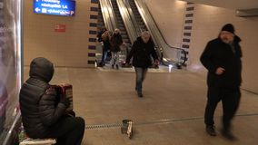 OLOMOUC, CZECH REPUBLIC, MARCH 5, 2018: Gypsy man in city begging money into a cup, authentic plays music the accordion. Gypsy man in city begging money into a stock video footage
