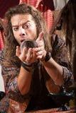 Gypsy Man with Crystal Ball Stock Photos