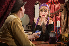 Gypsy Reading Tea Leaves Royalty Free Stock Photos
