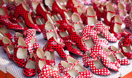 Gypsy red shoes with polka dot spots. In shop market Stock Image
