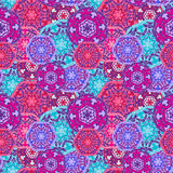 Gypsy seamless pattern of abstract multicolored round mandalas. Ethnic background Royalty Free Stock Image