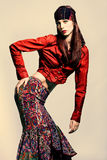 Gypsy style. Red hair woman in fashion gypsy style clothes royalty free stock photography