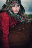 Gypsy style fashion. Young blue eyes blonde woman in gypsy style fashion, outdoor windy day royalty free stock image