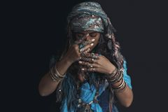 Gypsy style young woman wearing tribal jewellery portrait royalty free stock photos