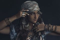 Gypsy style young woman wearing tribal jewellery portrait Royalty Free Stock Photography