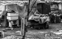 Gypsy unhygienic settlement in Belgrade, b&w. Gypsy settlement in Belgrade. Life in unhygienic condition with a lot of garbage. Our neighborhood, Belgrade Royalty Free Stock Photography