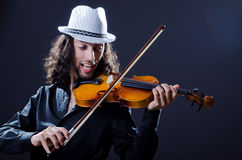 Gypsy violin player in studio Royalty Free Stock Photo