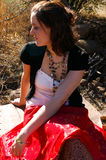 Gypsy woman 2. Woman sitting down and looking away Royalty Free Stock Image