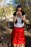 Gypsy woman 6. Woman smelling something in her hands Stock Photo