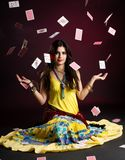 Gypsy woman with and cards. Magic Royalty Free Stock Images