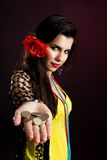 Gypsy woman with coins Royalty Free Stock Photos