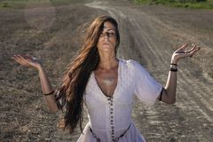 Gypsy woman on the dirty road 3 stock image