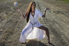 Gypsy woman on the dirty road royalty free stock photo