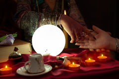Gypsy woman doing palm reading. With another woman royalty free stock photography