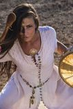Gypsy woman drumming. On the reoad Royalty Free Stock Photo