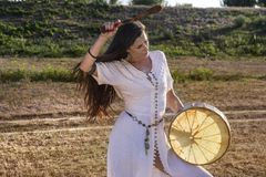 Gypsy woman drumming. 2 u Stock Photos