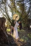 Gypsy woman in the forest drumming Royalty Free Stock Photo