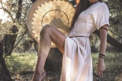 Gypsy woman in the forest drumming Royalty Free Stock Photos