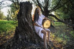 Gypsy woman in the forest drumming 2 Stock Images