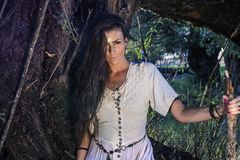 Gypsy woman in the forest stock photography