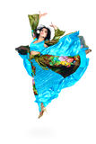 Gypsy woman jumping against isolated white background Stock Photography