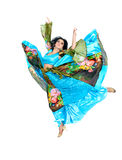 Gypsy woman jumping against isolated white Royalty Free Stock Images