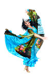 Gypsy woman jumping against isolated white Royalty Free Stock Image