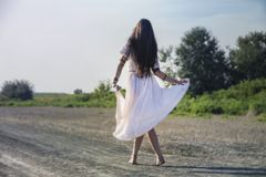 Gypsy woman on the road. Dancing stock photo