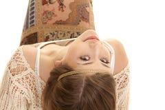 Gypsy woman sit backwards lean back look Stock Image
