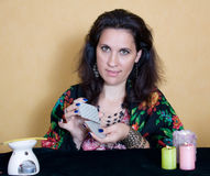 Gypsy woman sitting with cards. Royalty Free Stock Image