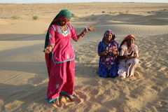 Gypsy women dancing and singing in the Desert, Rajasthan, India Stock Photos