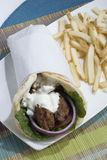 Gyro. A Greek Gyro with French Fries Stock Photos